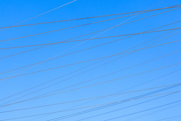 power lines in rural landscape with blue sky