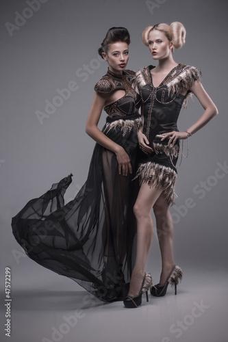 two beautiful caucasian women in gorgeous dress
