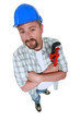 plumber with folded arms holding spanner