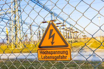 warning sign at hight voltage tower