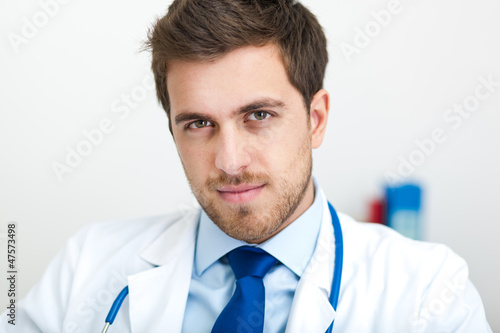 Doctor sitting in his studio