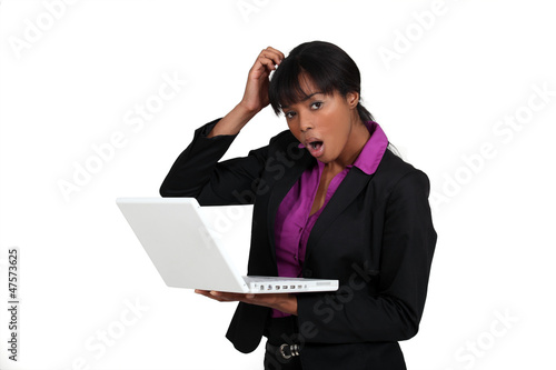 Shocked woman holding laptop