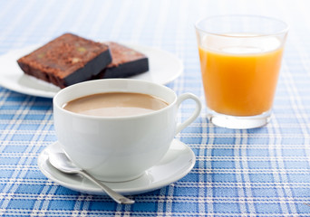 Breakfast with coffee, orange juice and chocolate cake