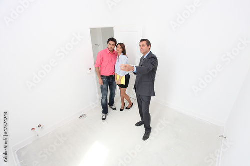 Couple being shown around a new property