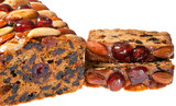 Christmas cake slices with cherries almonds and brazil nuts.