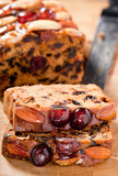 Christmas cake slices with cherries almonds and brazil nuts