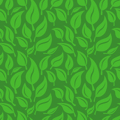 Vector seamless background with green leaves