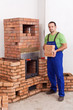 Professional worker building masonry heater