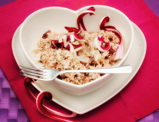 red chicory risotto in a heart shape plate