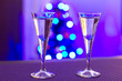 Two glasses of vodka with blurry christmas tree background