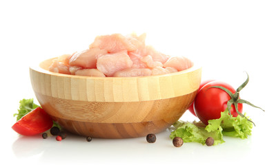 raw chicken meat in wooden bowl, isolated on white