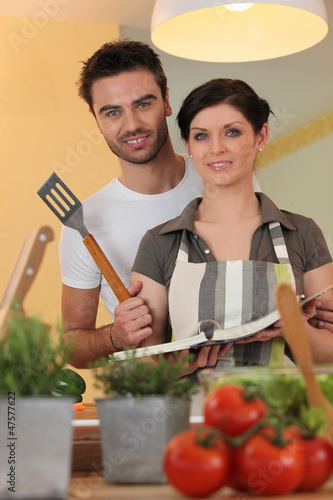Couple with a cookbook