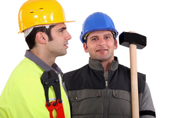 duo of male carpenters against studio background