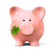 Leinwanddruck Bild - Piggy bank with four leaf clover