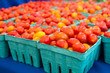 Baskets of fresh cherry tomatoes