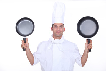 Chef with two pans