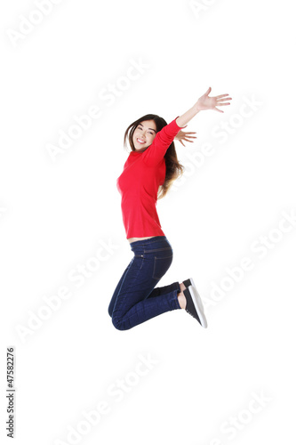 Happy caucasian woman jumping in the air