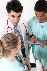 A team of medical professionals conferring