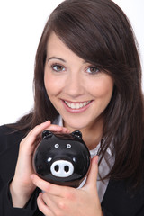 Brunette woman with piggy bank
