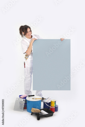 Painter holding blank board