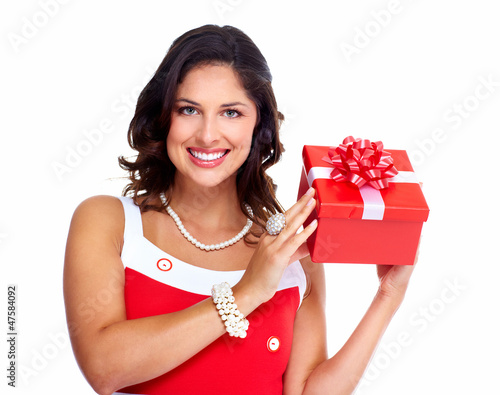 Beautiful young girl with a Christmas present.