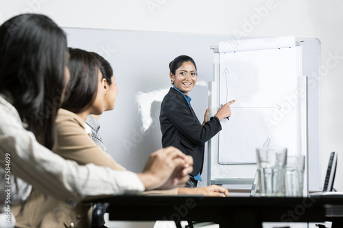 business woman drawing chart at meeting