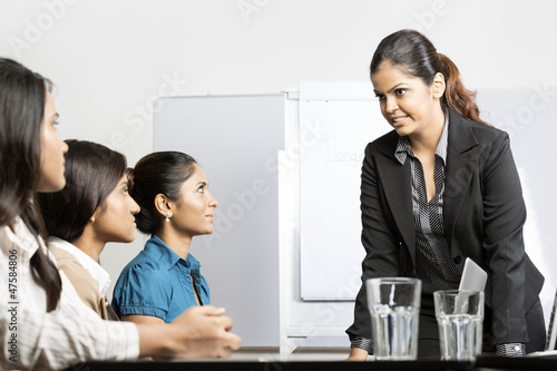 Group of business women having a meeting.