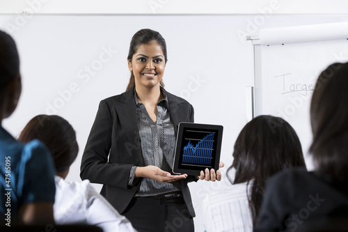 Indian Business woman giving presentation.