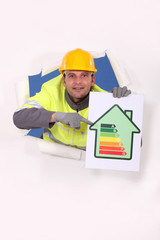 Worker with an energy rating sign
