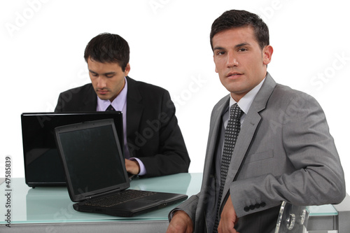 Confident worker sitting at his desk
