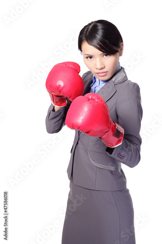 Confident business woman with boxing gloves
