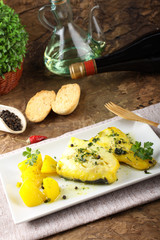 Fresh cod with potatoes and saffron