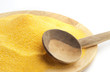 polenta on wooden plate and spoon
