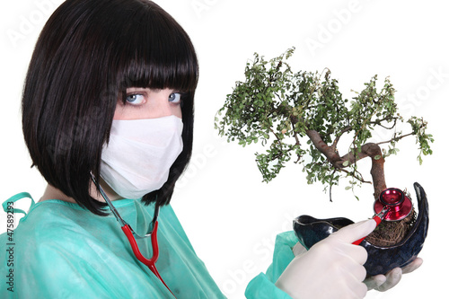 Female doctor with banzai tree