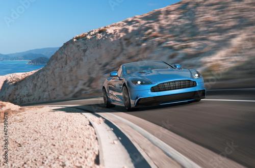 obraz PCV blauer luxussportwagen am Berg
