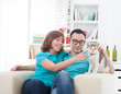 asian couple with cat.
