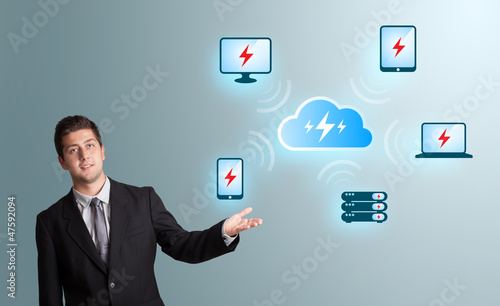 Young man presenting cloud computing network