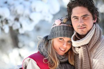 Couple on a winter walk through the snow