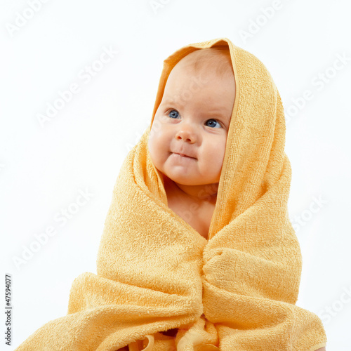 baby in yellow towel
