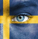 Human face painted with flag of Sweden