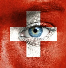Human face painted with flag of Switzerland