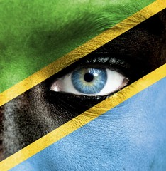 Human face painted with flag of Tanzania