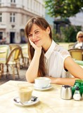 Relaxed Woman Enjoying in an Open Air Cafe