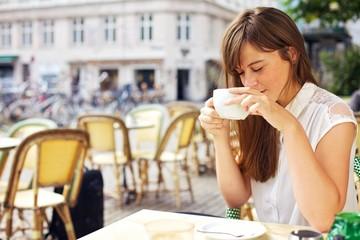 Woman Enjoying the Aroma of Her Coffee