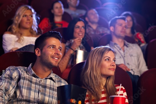 Young people sitting at movie theater