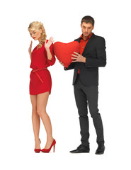 beautiful couple holding big heart