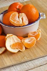 Fresh ripe mandarines on wooden background