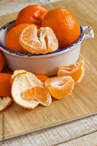 Fresh ripe mandarines on wooden background