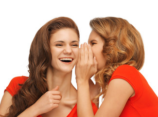 two talking teenage girls in red t-shirts