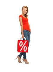 teenage girl in red t-shirt with shopping bag